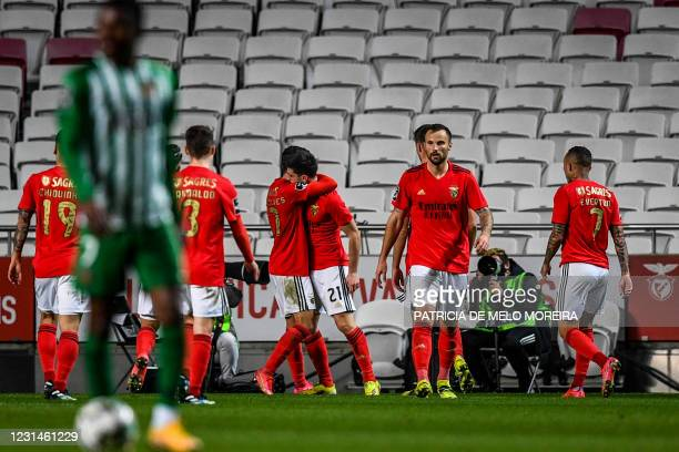 Benfica's Portuguese midfielder Pizzi Fernandes celebrates with teammates after scoring a goal during the Portuguese league football match between SL...