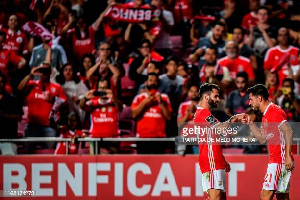 Benfica's Portuguese midfielder Pizzi Fernandes celebrates with his teammate Benfica's Portuguese midfielder Rafa after scoring a goal during the...
