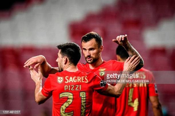 Benfica's Portuguese midfielder Pizzi Fernandes celebrates with his teammate Benfica's Swiss forward Haris Seferovic at the end of the Portuguese...