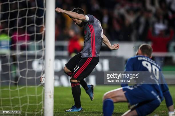 Benfica's Portuguese midfielder Pizzi Fernandes scores a goal during the Portuguese league football match between Vitoria FC and SL Benfica at the...