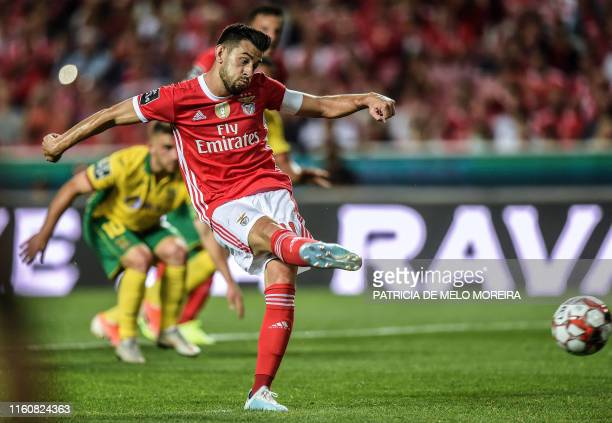 Benfica's Portuguese midfielder Pizzi Fernandes shoots a penalty kick to score a goal during the Portuguese league football match between SL Benfica...
