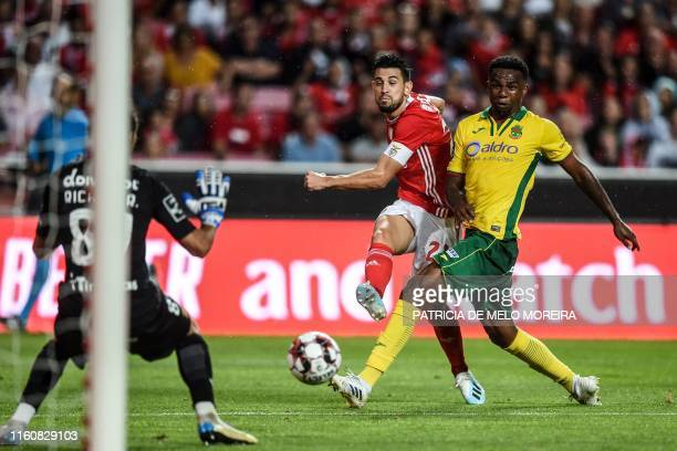 Benfica's Portuguese midfielder Pizzi Fernandes shoots to score a goal during the Portuguese league football match between SL Benfica and FC Pacos de...