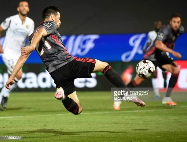 Benfica's Portuguese midfielder Pizzi kicks the ball during the Portuguese League football match between Famalicao and Benfica at the Famalicao...