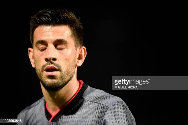 Benfica's Portuguese midfielder Pizzi reacts at the end of the Portuguese League football match between Famalicao and Benfica at the Famalicao...