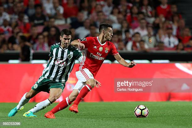 Benfica's Portuguese midfielder Pizzi tries to pass trough Setubal's defender Frederico Venancio from Portugal during the match between SL Benfica...
