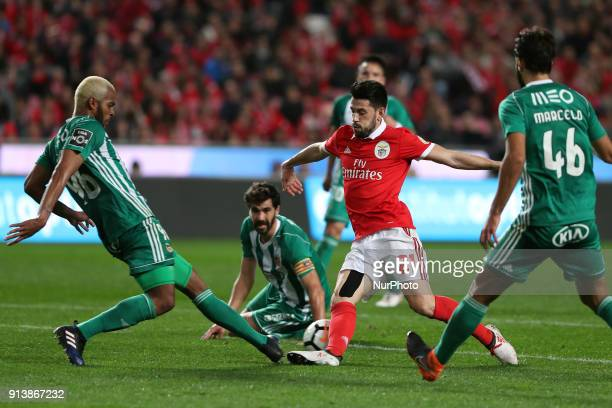 Benfica's Portuguese midfielder Pizzi vies with Rio Ave's defender Marcao during the Portuguese League football match SL Benfica vs Rio Ave FC at the...
