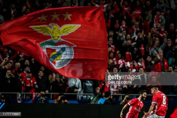 Benfica's Portuguese midfielder Rafa Silva celebrates with teammate Benfica's Spanish midfielder Gabriel Appelt after scoring a goal during the UEFA...