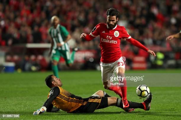Benfica's Portuguese midfielder Rafa Silva vies with Rio Ave's goalkeeper Cassio during the Portuguese League football match SL Benfica vs Rio Ave FC...