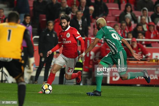 Benfica's Portuguese midfielder Rafa Silva vies with Rio Ave's defender Marcao during the Portuguese League football match SL Benfica vs Rio Ave FC...