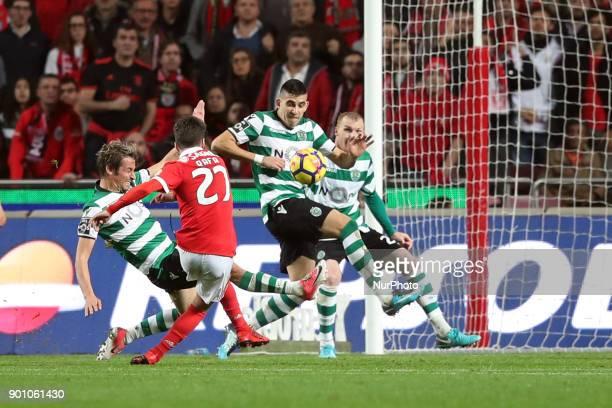 Benfica's Portuguese midfielder Rafa Silva vies with Sporting's defender Fabio Coentrao from Portugal and Sporting's midfielder Rodrigo Battaglia...
