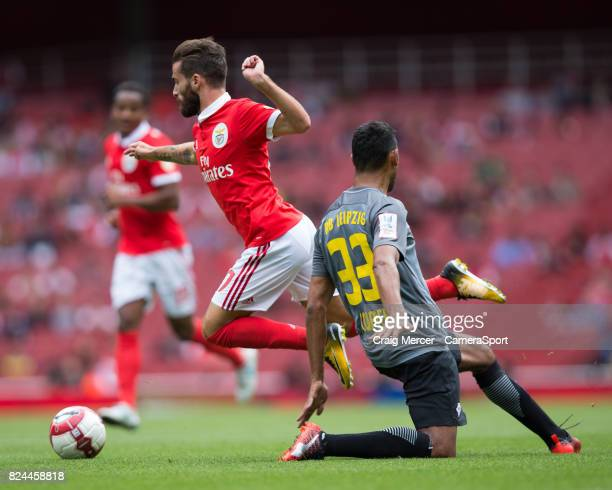 Benficas Rafa Silva is fouled by RB Leipzig's Marvin Compper during the Emirates Cup match between RB Leipzig and SL Benfica at Emirates Stadium on...