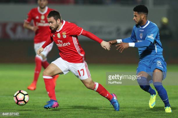 Benfica's Serbian forward Andrija Zivkovic vies with Feirense's midfielder Babanco during the Premier League 2016/17 match between CD Feirense and SL...