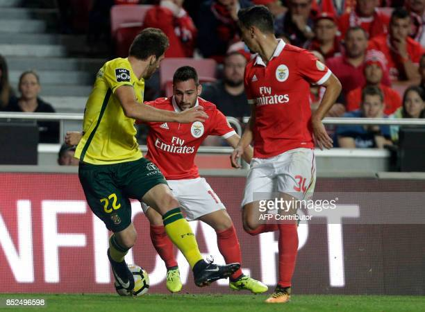 Benfica's Serbian forward Andrija Zivkovic vies with Pacos Ferreira's defender Miguel Vieira past and his teammate defender Andre Almeida during the...