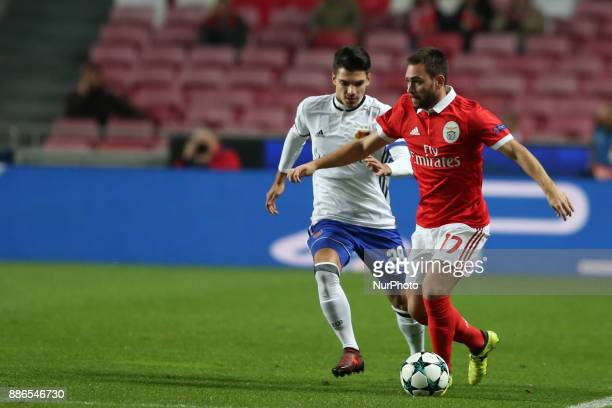 Benfica's Serbian midfielder Andrija Zivkovic vies with Basel's midfielder Raoul Petretta from Italy during the UEFA Champions League Group A...