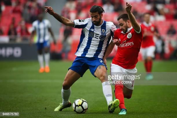 Benfica's Serbian midfielder Andrija Zivkovic vies with Porto's midfielder Sergio Oliveira during the Portuguese league footbal match between SL...
