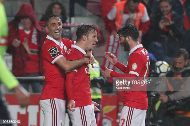 Benfica's Spanish defender Alejandro Grimaldo celebrates after scoring a goal with Benfica's Brazilian forward Jonas and Benfica's Portuguese...