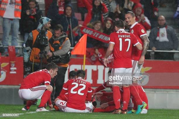 Benfica's Spanish defender Alejandro Grimaldo celebrates with teammates after scoring during the Portuguese League football match SL Benfica vs...