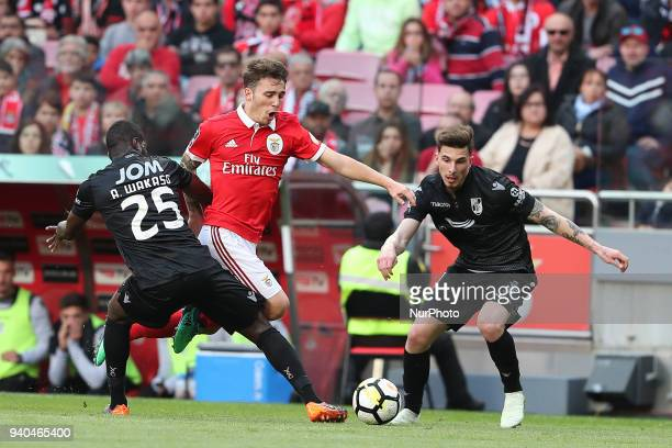 Benfica's Spanish defender Alejandro Grimaldo vies with Vitoria Guimaraes' midfielder Wakaso of Gana during the Portuguese League football match SL...