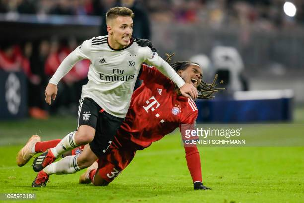 Benfica's Spanish defender Alex Grimaldo and Bayern Munich's Portuguese midfielder Renato Sanches vie for the ball during the UEFA Champions League...