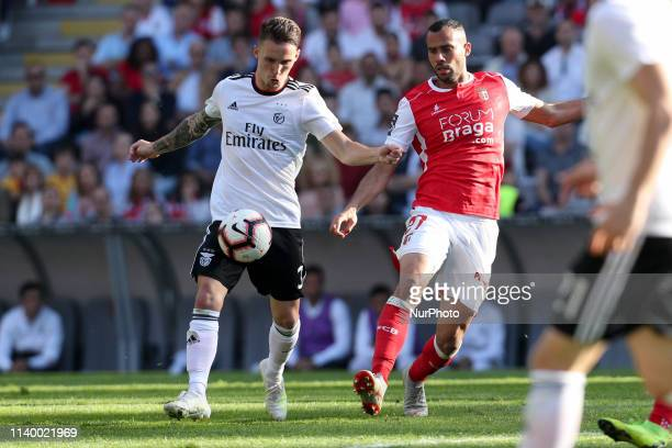 Benfica's Spanish defender Alex Grimaldo in action with Sporting Braga's Portuguese forward Fabio Martins during the Premier League 2018/19 match...