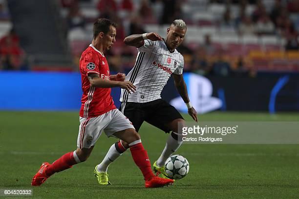 Benfica's Spanish defender Alex Grimaldo vies with Besiktas JK's forward Ricardo Quaresma from Portugal during the UEFA Champions League Match...