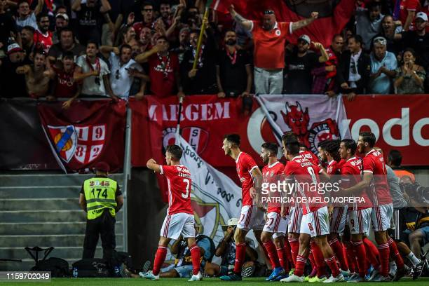 Benfica's Spanish defender Grimaldo Garcia celebrates a goal with teammates during the Portugal's Candido de Oliveira Super Cup final football match...