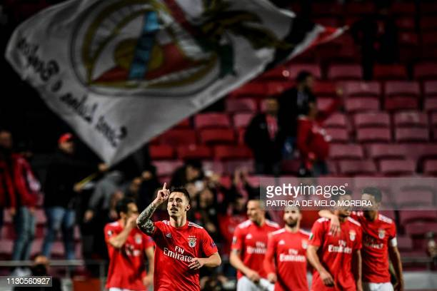 Benfica's Spanish defender Grimaldo Garcia celebrates his goal during the UEFA Europa League round of 16 second leg football match between SL Benfica...
