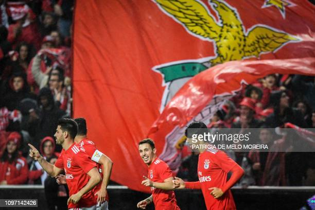 Benfica's Spanish defender Grimaldo Garcia celebrates with his teammates after scoring during the Portuguese League football match between SL Benfica...