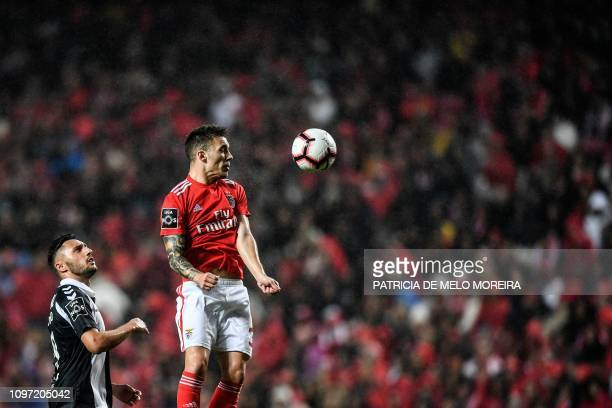 Benfica's Spanish defender Grimaldo Garcia vies with Nacional's forward Camacho during the Portuguese League football match between SL Benfica and CD...
