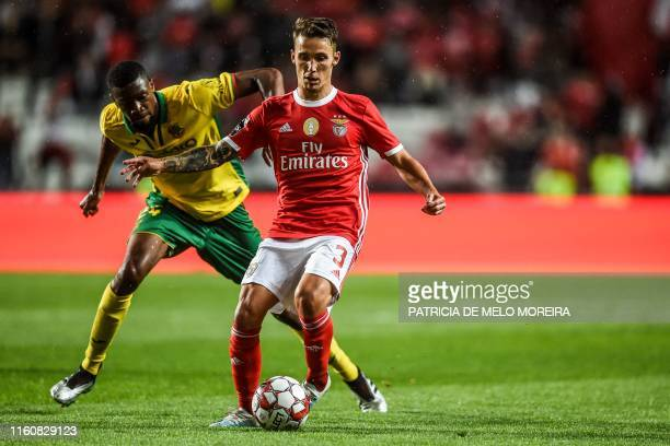 Benfica's Spanish defender Grimaldo Garcia vies with Pacos de Ferreira's French midfielder Mohamed Diaby during the Portuguese league football match...