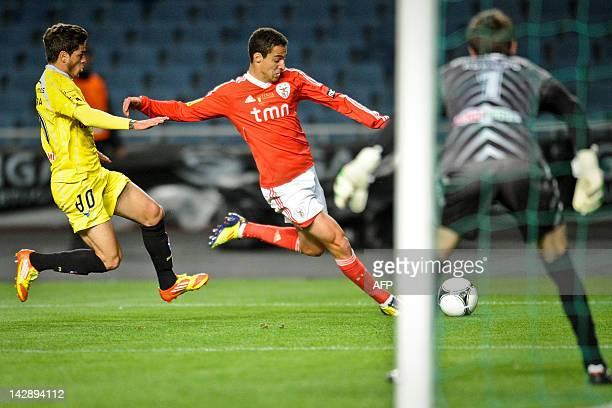 Benfica's Spanish forward Rodrigo Machado vies with Gil Vicentes's Brazilian defender Junior Caiara during their Portuguese League Cup final match at...