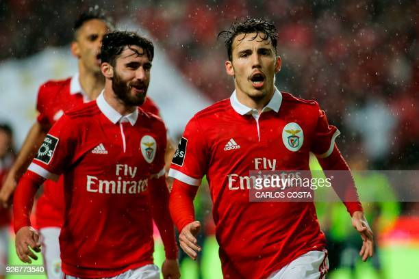 Benfica's Spanish midfielder Alex Grimaldo celebrates a goal with Benfica's midfielder Rafa Silva during the Portuguese league football match between...