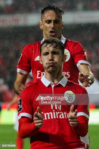 Benfica's Spanish midfielder Alex Grimaldo celebrates a goal with Benfica's Brazilian forward Jonas during the Portuguese league football match...