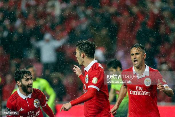 Benfica's Spanish midfielder Alex Grimaldo celebrates a goal with Benfica's midfielder Rafa Silva and Benfica's Brazilian forward Jonas during the...