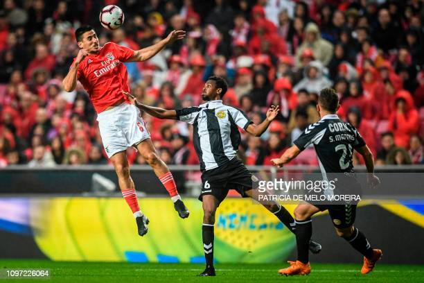 Benfica's Spanish midfielder Gabriel Appelt vies with Nacional's Nigerian midfielder Alhassan and Nacional's midfielder Sergio Marakis during the...