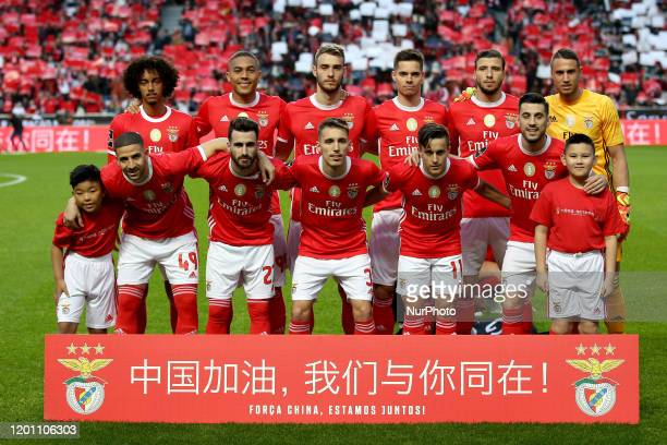 Benfica's starter team pose with two young Chinese boys as a way to honor the Chinese people struggling with the coronavirus epidemic before the...