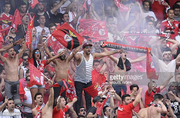 Benfica's supporters jubilate before the start of the Portuguese league football match Vitoria SC vs SL Benfica at the Dom Afonso Henriques stadium...
