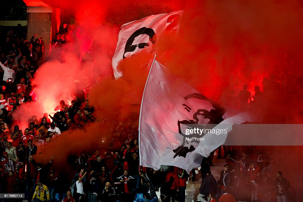 Benfica's supporters wave flags and cheer their team during Premier League 2016/17 match between CF Belenenses vs SL Benfica, in Lisbon, on October 23, 2016.NURPHOTO