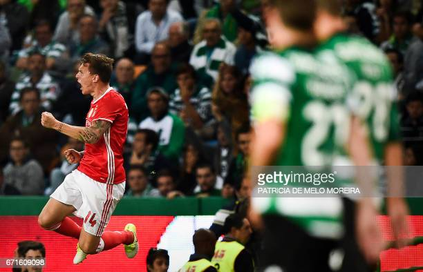 Benfica's Swedish defender Victor Lindelof celebrates after scored against Sporting CP during the Portuguese League football match Sporting CP vs SL...