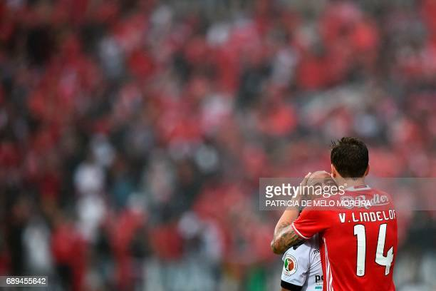 Benfica's Swedish defender Victor Lindelof comforts Vitoria Guimaraes' Colombian midfielder Guillermo Celis at the end of the Portugal's Cup final...