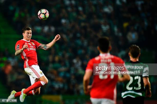 Benfica's Swedish defender Victor Lindelof heads the ball during the Portuguese League football match Sporting CP vs SL Benfica at Alvalade stadium...
