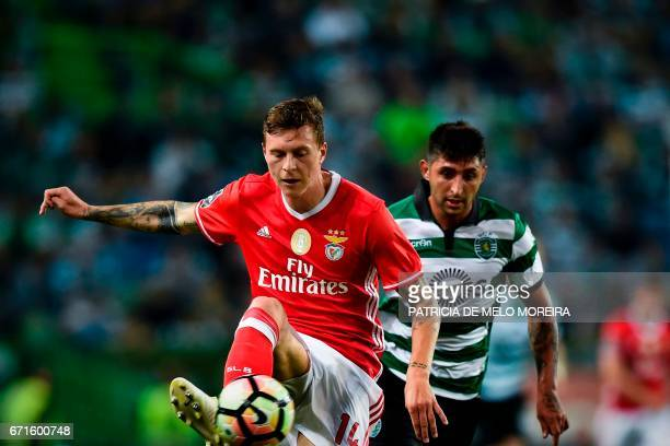 Benfica's Swedish defender Victor Lindelof vies with Sporting's Argentine midfielder Alan Ruiz during the Portuguese league football match Sporting...