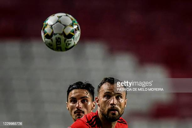 Benfica's Swiss forward Haris Seferovic and Pacos de Ferreira's Canadian midfielder Stephen Eustaquio eye the ball during the Portuguese League...