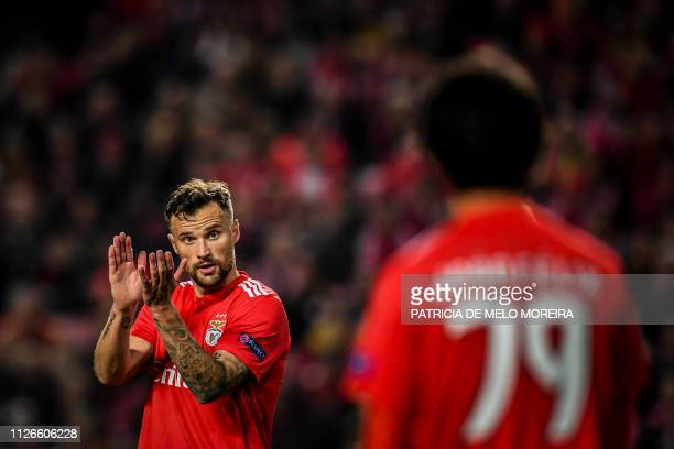 Benfica's Swiss forward Haris Seferovic applauds next to Benfica's midfielder Joao Felix during the UEFA Europa League round of 32 second leg...