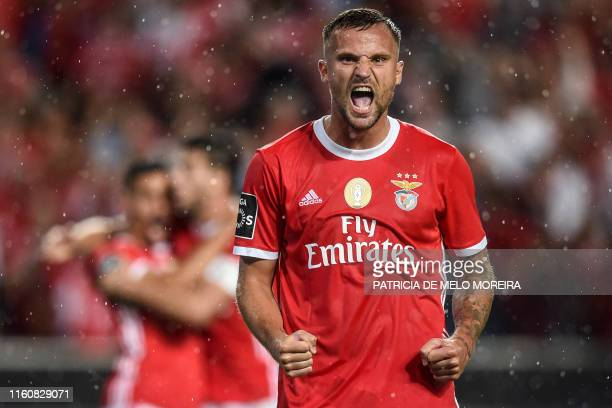 Benfica's Swiss forward Haris Seferovic celebrates a goal during the Portuguese league football match between SL Benfica and FC Pacos de Ferreira at...