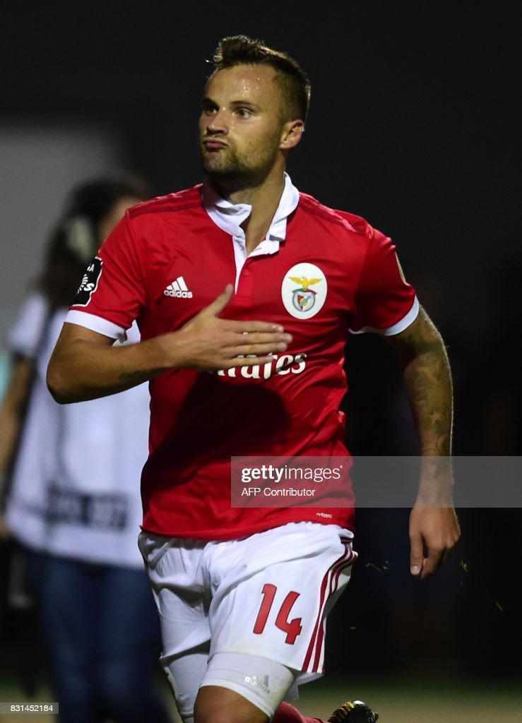 Benfica's Swiss forward Haris Seferovic celebrates after scoring a goal during the Portuguese league football match between GD Chaves and SL Benfica at the Municipal Eng. Manuel Branco Teixeira stadium in Chaves on August 14, 2017. /