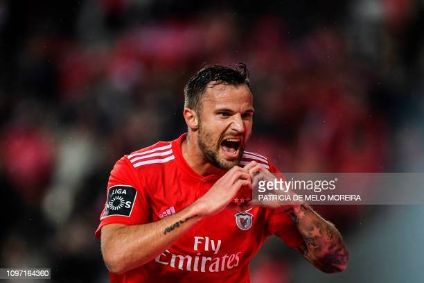 Benfica's Swiss forward Haris Seferovic celebrates after scoring during the Portuguese League football match between SL Benfica and CD Nacional at...
