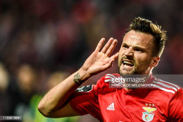 Benfica's Swiss forward Haris Seferovic celebrates after scoring during the Portuguese league football match between SL Benfica and CD Tondela at the...