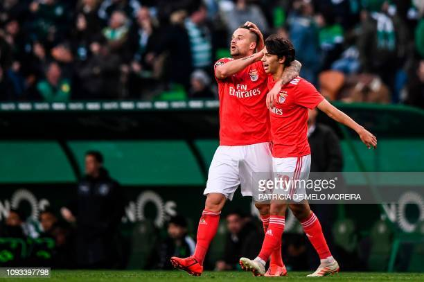 Benfica's Swiss forward Haris Seferovic celebrates with his teammate Benfica's midfielder Joao Felix after scoring during the Portuguese League...