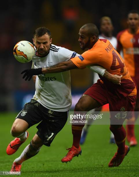 Benfica's Swiss forward Haris Seferovic fights for the ball with Galatasaray's Brazilian defender Marcao during the UEFA Europa League round of 32...